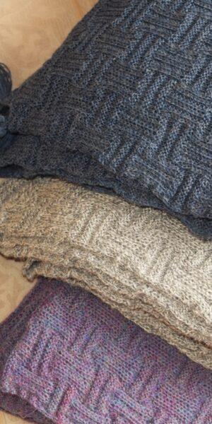 Handknit scarf with handmade pompoms