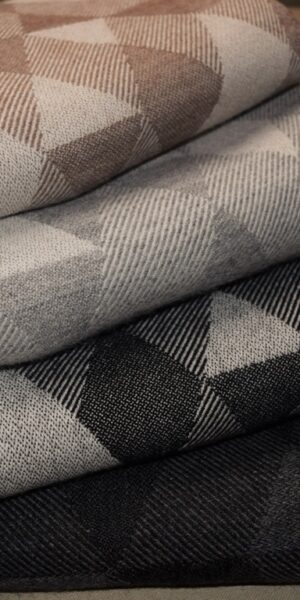 Woven blankets with handmade edges