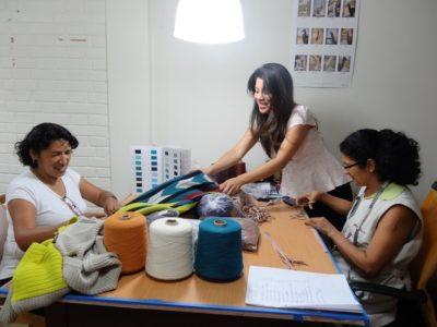 Pilar-supervising-knitters-Teresa-and-Maria